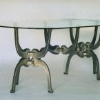 """""""Untitled Table"""", 84 inches long by 42 inches wide by 30 inches tall, welded steel, 1997. Flame cut from 1"""" mild steel plate, the 3 piece steel base weighs less than the glass top. ■  As Fejes Design I operated in Seattle from 1990 to 2000 building a product line, one-off furniture and sculpture. Seattle was a wonderland for me full of state of the art processes and new materials.  ■"""