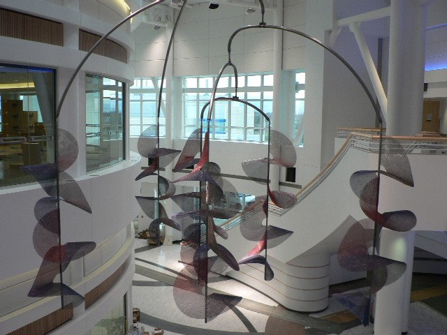 """Aurora Mobile"" was commissioned by the Department of Defense for a new military hospital in Fairbanks Alaska. It was conceived and fabricated in collaboration with Wendy Ernst Croskrey, professor of sculpture, University of Alaska Fairbanks. It has ball bearing swivels at all joints and weighs a total of 350 pounds. It was installed in October of 2006 in the atrium of the Bassett Army Hospital, Fairbanks Alaska. ■"