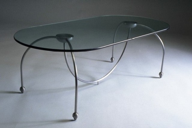 """""""5 legged table"""", 42 inches long by 24 inches wide by 18 inches tall, welded steel, glass and really good glue, 1992. The fifth central leg imbeds in the carpet to provide stability. ■"""