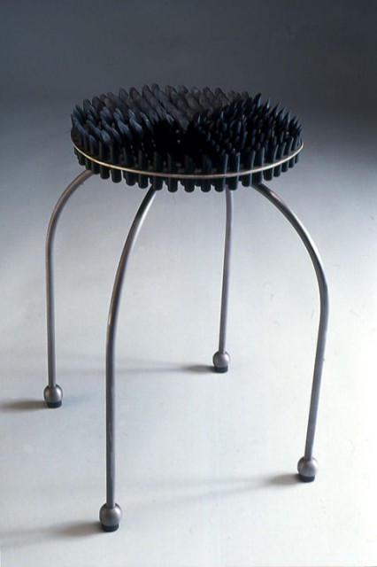 """""""Work Chair"""", 19"""" dia. X 24"""" tall, mild steel and buna rubber rod, and won the 'Best Chair award' of the 1992 Table Lamp + Chair exhibit in Portland, Oregon ■"""