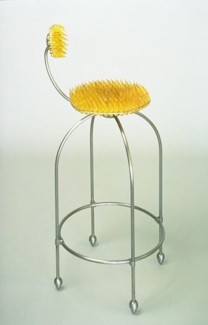 """""""Next Generation Work Chair"""", 41 inches tall by 16 inches in diameter, welded steel bar, stainless steel plate and custom molded soft polyurethane elastomer (it only looks like broken glass), 1992 ■"""