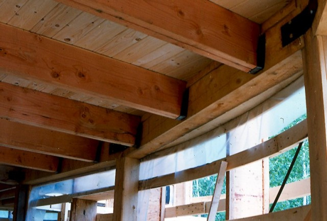"""This super insulated timber framed group of truncated vertical cylinder sections was a featured article in the Fine Homebuilding Magazine, """"Superinsulating the Non Box"""", Feb/mar 1984. ■"""