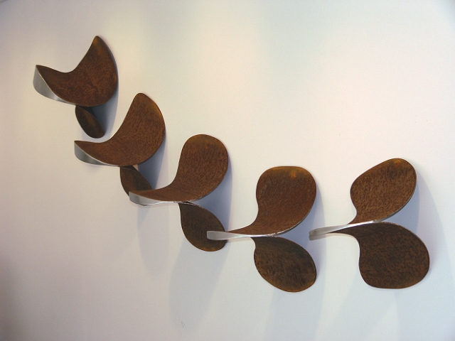 """Vertebrae Quintych"", 8 feet wide by 2 feet tall by 1 foot deep, welded ""Artifact Steel"" and stainless steel, 2004"