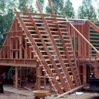 "The curved exterior walls (outside/in) are; cedar shingles on 30# felt on horizontal 1x4 @ 5"" o.c. skip sheath on 12"" truss joist @ 48"" o.c. This 48"" wide cavity is insulated with 12"" of fiberglass insulation. ■"