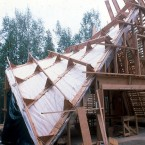 "The roof (outside/in) is; cedar shingles on 30# felt on 1x4 @ 5"" o.c. skip sheath on 2x4 @ 16"" o.c. ventilated air space on 12"" truss joist @ 48"" o.c. and on pylons that provide an 18"" fiberglass insulation cavity on the vapor barrier on 1x6 board on board finished ceiling on the timber frame. ■"